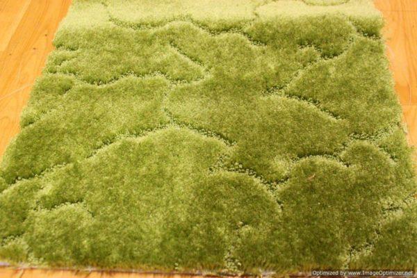 На фото – ковролин зеленого цвета с фактурным рисунком.