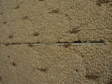 Необработанные края ковролина