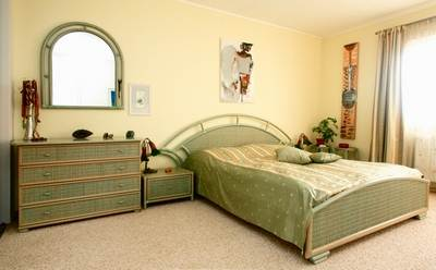 Покрытие пастельных тонов в спальне.