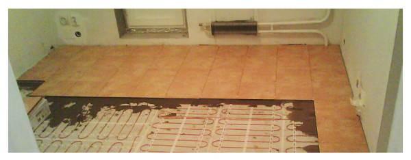 Укладка плитки на теплый пол.