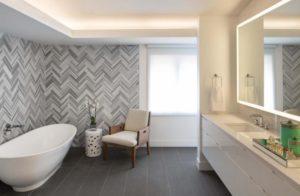 Стили отделки ванной комнаты плиткой. Укладка елочка