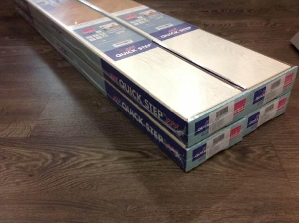 Вес упаковки ламината QUICK-STEP 32 класса весит 12 кг